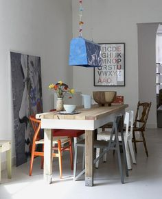 Love this wood table and hodgepodge of chair styles/colours