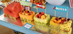 A train made out of fruit. Watermelon, kiwi, pineapple, what else is there?