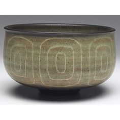"Harrison McIntosh bowl, footed shape with incised geometric designs, covered in a green and brown matte glaze, signed, paper label, 6""w x 3.5""h"