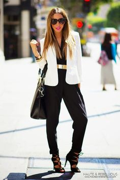 Stand out among other stylish civilians in a white blazer and a black jumpsuit. Grab a pair of black suede heeled sandals to instantly up the chic factor of any outfit. Shop this look on Lookastic: https://lookastic.com/women/looks/blazer-jumpsuit-heeled-sandals/13801 — White Blazer — Gold Waist Belt — Black Leather Tote Bag — Black Jumpsuit — Black Suede Heeled Sandals