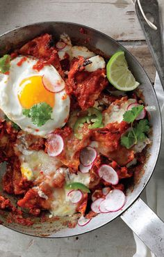 Chilaquiles with Fried Eggs -This Mexican dish of tortilla chips smothered in chile sauce is just as good for dinner as it is for breakfast. Egg Recipes, Mexican Food Recipes, Great Recipes, Cooking Recipes, Favorite Recipes, Cooking Tips, Epicurious Recipes, Dinner Recipes, Healthy Recipes