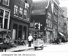 1930's. Ice cream vendor on the Lindengracht in the Jordaan neighborhood of Amsterdam. The Lindengracht is not, as the name may suggests, a canal. It is one of a range of canals that was filled-in about 120 years ago. On Saturdays the Lindengracht is reserved for a market, the Lindengracht Markt. The market, which is almost 120 years old, consists of approximately 232 stalls with a large variety of merchandise. #amsterdam #1930 #Lindengracht #Lindengrachtmarkt #Jordaan