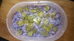 Finely chopped zucchini in blueberry cashew sauce with raisin, dried cranberries, shredded coconut and grapes on the top
