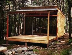 Like the glass wall idea, also, significant porch   http://tinyhousetalk.com/shelter-kit-tiny-prefab-cabins/#