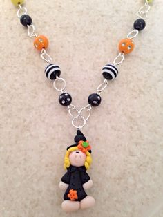 Check out this item in my Etsy shop https://www.etsy.com/listing/245189331/polymer-clay-little-girl-witch-beaded