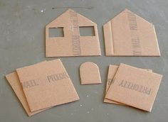 Cart Before The Horse: Little Houses for You and Me. **Maybe place photos of each person/pet in window? Cardboard Gingerbread House, Cardboard Box Houses, Paper Houses, Cardboard Crafts, Paper Crafts, Diy Christmas Ornaments, Christmas Home, Christmas Cupcakes, Diy Fairy Door