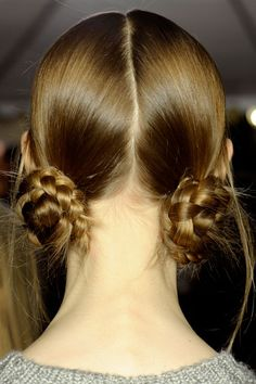 Marc Jacobs  These two braided buns look chic with a hat, as was shown on the runway, or on their own. To create the coils, Guido pulled hair into two low ponytails and secured with an elastic. Then he braided each tail and wrapped it around to form a knot.        Read more: Fall 2012 Fashion Beauty - Best Hair and Makeup at New York Fashion Week