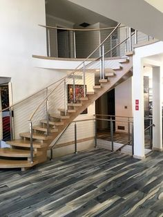 Nina - SS cable railing with white oak handrail. Houses Architecture, Architecture Design, Foyers, Cable Stair Railing, Curved Staircase, Staircase Ideas, Stainless Steel Cable Railing, Curved Wood, Floating Stairs