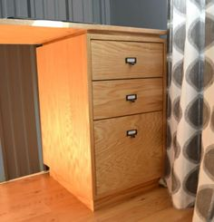 I want to make this!  DIY Furniture Plan from Ana-White.com  Base cabinet inspired by West Elm Modular Office Collection, made with PureBond Formaldehyde Free Plywood. Bottom drawer sized for files.