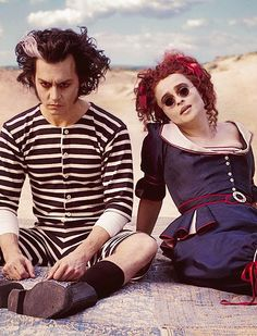 IMAGE 10: This is from the film sweeney todd the demon barber. This films story line is similar to the one that i am wanting to create my characterization from. In this image she is sining about how life could be together and it is happy which is why the bright colours are used but it contrasts against their pale skin.