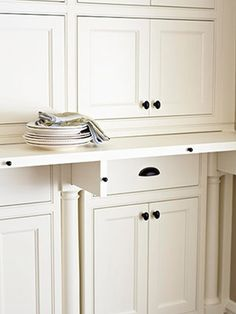 antique hutch has pull out shelf to use when you're putting away or removin gitems. handy!!!!!