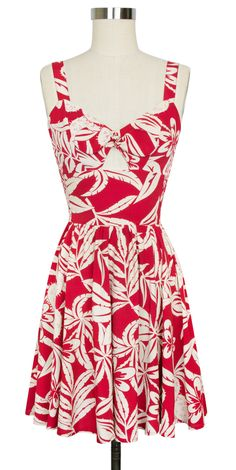 Inspired by the tropics, the retro Cactus Rouge Collection features a bold print of cacti flowers in cream on a vibrant red background. The name says it all! Trashy Diva's super retro inspired Hottie Mini Dress in our light and airy rayon is perfect for summer. This vintage-inspired design features a front center tie that is stitched together then completed with a cutout above the waist. #trashydivahottiedress #trashydivacactusrouge