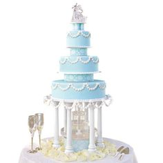 Daisy Delicacy Cake - Softly shaded tiers draped in daisies are linked by pretty Tailored Tiers separators, each covered with fondant in a lively imprinted design. The illuminated fountain and the dazzling crystal-look topper complete the look.