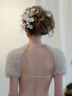 12 New Wedding Hairstyles You'll Love - This side swept, deconstructed bun  decorated with flowers at Angel Sanchez was a standout look on the runway
