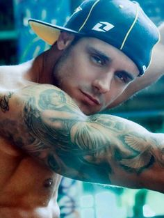 tattoos and muscles!
