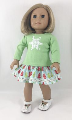 This handmade, 2 piece set will fit most 18 inch dolls such as American Girl. Pretty pastels with cheery red accents make a pretty Winter fun outfit for your doll! The graphic tee has a white snowflak