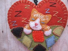 Ginger Kitten Napping Ornament by SandhraLee on Etsy