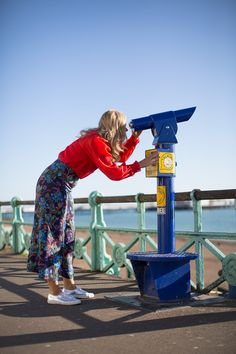 H&M floral trousers and red blouse on the Sea Front