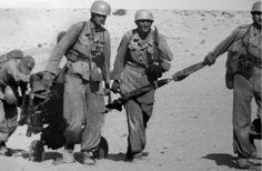 """reparations: """"DAK Fallschirmjäger transporting a Schwere Panzerbüchse 41. """""""