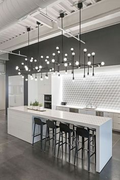 Modern kitchen black and white design. Modern kitchen organization would be the heaven of housewife or housemen, You will find some modern kitchen decor ideas via this gallery.