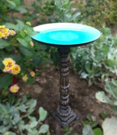 This DIY bird bath is simply an old candlestick, a pretty plate and some Gorilla Glue! Great re-purposed bird bath! If the candlestick is hollow (or you can drill out the bottom) insert a stake into the ground, then slip the candlestick over the stake to give it more stability. If it's a heavy metal candlestick, you have it made!
