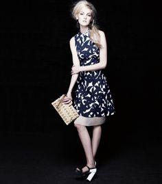 crushculdesac:  Caroline Trentini in a Marni printed dress, calfskin clutch and spectator sandals.  (The Book)