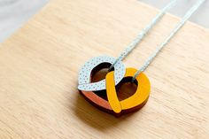 This twisted pretzel pendant. | 24 Wooden Accessories To Bring You Closer To Nature