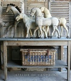 Collection of French brocante horses on zinc top table