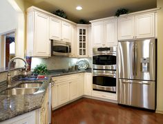 Toll Brothers kitchen, nice pckg, white cabinets, drk wood floors, countertops, ss appliances, nickel goose faucet! NICE!