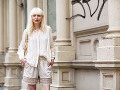 Street Style: somewhat bohemian look because of the short and with the pressed creamy shirt half tucked. Casual and cool for the summer