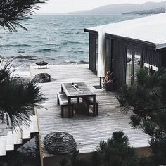 Waterside house: it must be amazing to sit on that decking and listen to the lapping of the waves.