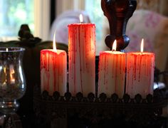 Blood Dripped Candles: All you need is a white Pilar candle or 4, a red taper candle and a lighter!