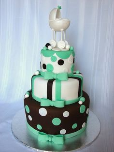 LOVE the colors on this cake.... just need to add a salmon/peachy pink! and get rid of the baby carriage.. :)