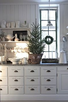 simple christmas kitchen. plus, i'll take those apothecary drawers, please.