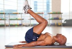 Train for Flat Abs: Reverse Crunch.    The reverse crunch targets the lower abs, which are tough to tone. Keep your arms at your sides, palms down. Use the abs to lift the legs, bringing the knees directly over the hips. Contract the abs further and raise your hips and lower back off the mat, knees toward your face. Hold briefly before lowering back to the mat. Don't let your feet touch the floor. Do three sets of 10-12 reps.