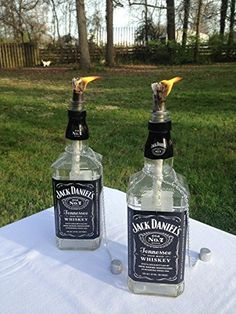 Place this piece in an outdoor patio or backyard getaway and enjoy. It's a Grand addition to any decor and these torches come with two Jack Daniels bottles that Jack Daniels Lampe, Jack Daniels Decor, Jack Daniels Bottle, Jack Daniels Party, Alcohol Bottles, Bottles And Jars, Alcohol Bottle Crafts, Empty Liquor Bottles, Liquor Bottle Lights