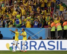 Brazil beats Cameroon 4-1, reaches 2nd round - Brazil's Neymar, second left, celebrates scoring the opening goal during the group A World Cup soccer match between Cameroon and Brazil at the Estadio Nacional in Brasilia, Brazil, Monday, June 23, 2014. (AP Photo/Dolores Ochoa)