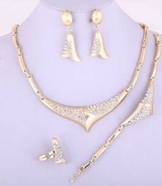 Chunky 4 Piece Gold Clear Bell Crystal Statement set. Starting at $12 on Tophatter.com!
