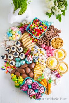 Let's eat all the Easter Treats!  This Dessert Board includes all the Easter desserts and candies.  It is a sweet Charcuterie Board for the holiday.  #platter #sweettreats #ideas #easter #desserts #charcuterie #chocolate #candy