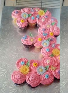 Age displayed with cupcakes, can be decorated with chocolate candy to match the party's theme.