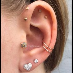 Ear Piercing Ideas: tragus, double forward helix, flat of ear, helix, and conch loops