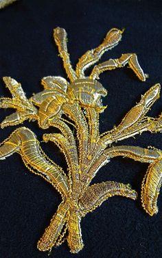 Wonderful gold metallic threaded rose applique, early 18th century.