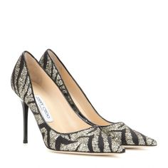 Jimmy Choo - Abel zebra lace and glitter pumps - The classic pumps are recreated the Jimmy Choo way - with sparkle! The 'Abel' is a pointed toe silhouette covered in zebra print lace, with a hint of shimmering pale gold glitter dotted all over. The contrasting lacquered heel is what keeps this pair contemporary. For a head-to-toe look, accessorise your LBD with these heels and the matching clutch. seen @ www.mytheresa.com #jimmychooheelssparkle