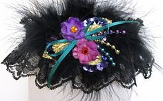 A touch of razzmatazz. You will outshine everyone with this tri-color of Purple Teal Pink Prom Garter from our Colorful and Classy collection. Style # Tri-B / Visit: www.garters.com/Prom_Garters_More-37c.htm