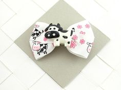 Moo Cows Hair Bows / Hair Clips with Resin Center $3.00 each. Classic and Simple style that works great for Party Favors, Stocking Stuffers, and Birthday Gifts, or as an addition to Pigtails and Ponytails.   Sample Party Themes: Farm, Animal, Ranch