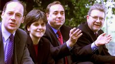 From left: SNP Deputy Convenor John Swinney, Vice Convenor Nicola Sturgeon, Leader Alex Salmond and Chief Executive Mike Russell sit down outside the Holiday Inn hotel in Edinburgh after a press conference held the day after Scottish parliamentary elections.