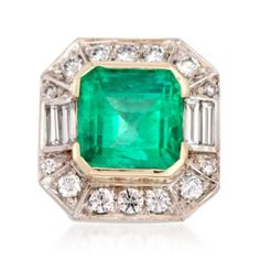 C. 1990. This ring from our Estate collection boasts a unique octagonal face where a 7.74 carat emerald sits center, surrounded by 1.60 ct. t.w. round and baguette diamonds. Dive into this colorful creation and bask in the glow this stunning emerald treasure! 18kt yellow and white gold ring.
