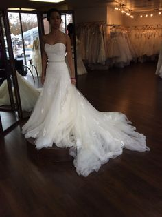 Long and dreamy, with a good amount of curve hugging. The tulle looks a bit messy