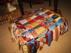 Old footstool cover in men's ties by Jim Gatling