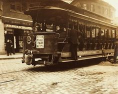Streetcar in Boston, Massachusetts with hitchhiking kid on the back. 1909, Lewis W. Hine. (1874 - 1940)